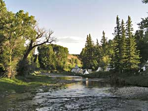 Rocky Mountain National Rendezvous tee pee camp along river photo